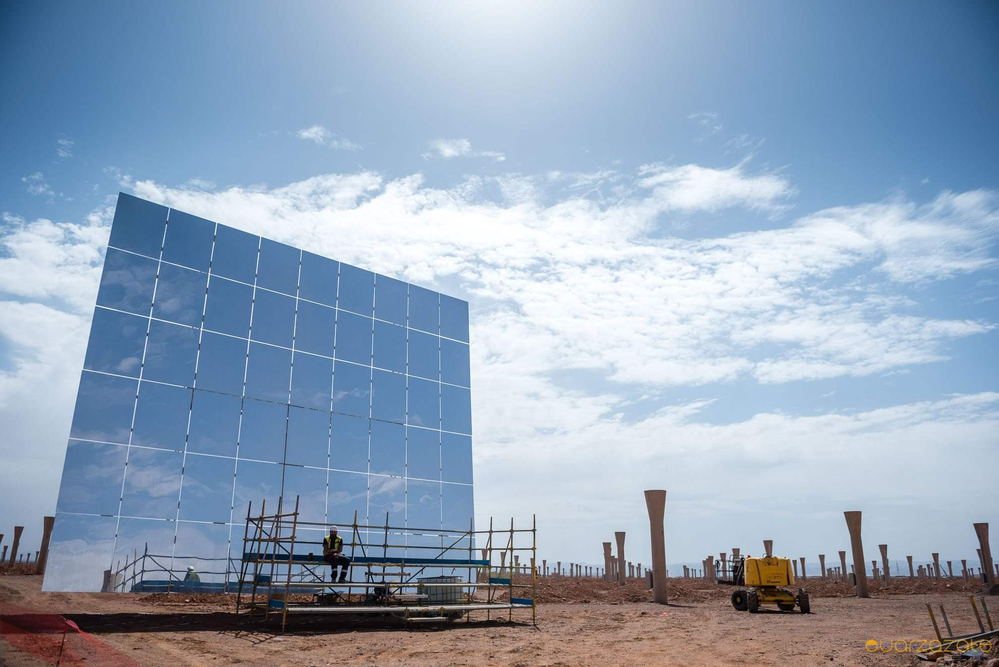 Worker infront of Huge mirrors Ouarzazate solar power station
